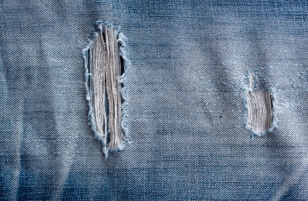 worn jeans: torn old blue jeans background Stock Photo