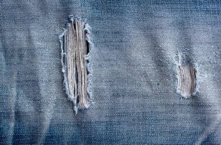 jeansstoff: zerrissenen alten blauen Jeans Hintergrund