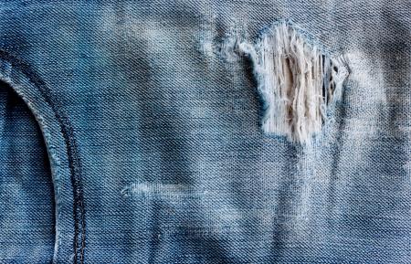 gescheurde oude blauwe jeans achtergrond