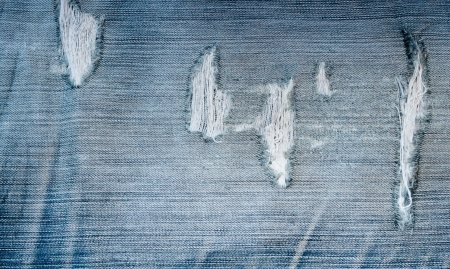 jeans fabric: torn old blue jeans background Stock Photo