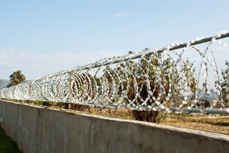 Fence with a barbed wire  photo
