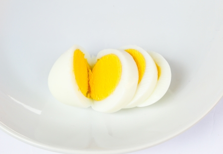 Boiled eggs sliced  on a plate photo