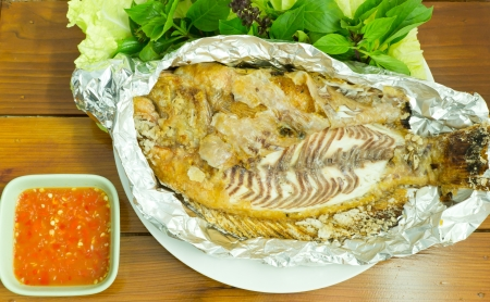 Grilled salted fish with fresh vegetable photo