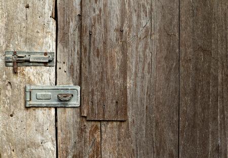 keep gate closed: lock on wooden door