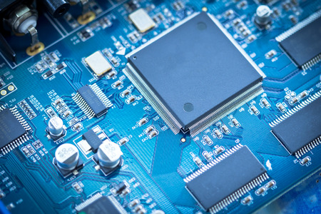 close up of electronic circuit chip on pcb board Standard-Bild