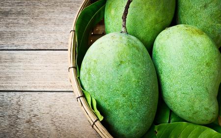 Fresh green mango on wooden table, Tropical fruit