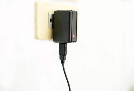 socket adapters: Mobile phone charger on electric outlet