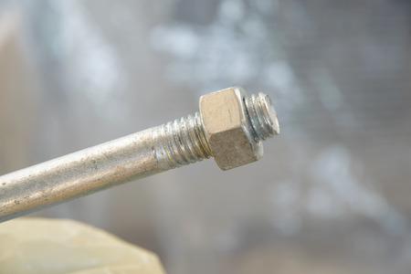 ねじ付き金属棒、亜鉛めっき糸棒のクローズアップ 写真素材