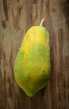 Papaya fruit on wooden background. Tropical fruit