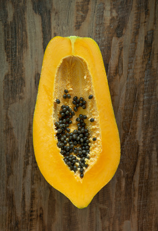 papaya slices on wooden background. top view