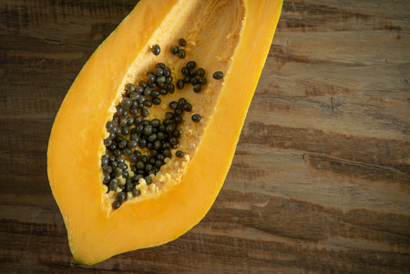 Papaya fruit on wooden background. Tropical fruit.Top view with copy space.