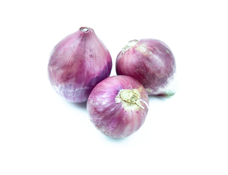 Thai red onion on white background, food ingredient Banco de Imagens