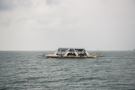 trat: KOH CHANG ISLAND, THAILAND - MARCH 20, 2015 - View of port ferry boat in Koh Chang Island, Trat, ,Thailand. Ferry services will take vehicles and passengers from the mainland to Koh Chang.