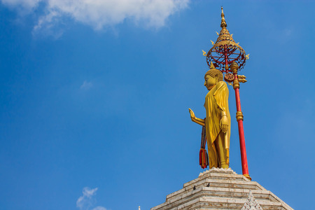 interdict: Golden Buddha stands on top of the temple.