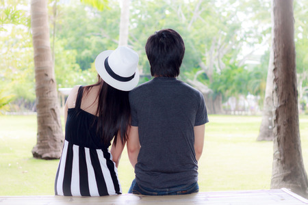 Couple shoulder in a park photo