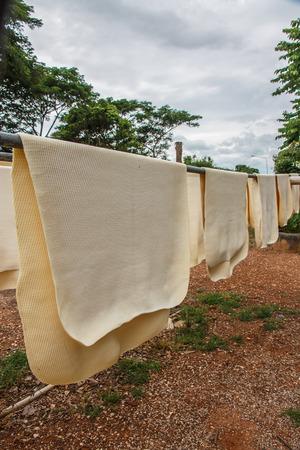rubber sheet: Para rubber sheet, dry in the sun.