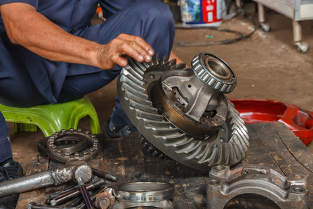 Professional car mechanic working in auto repair service  photo