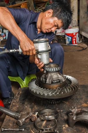 Professional car mechanic working in auto repair service. Reklamní fotografie