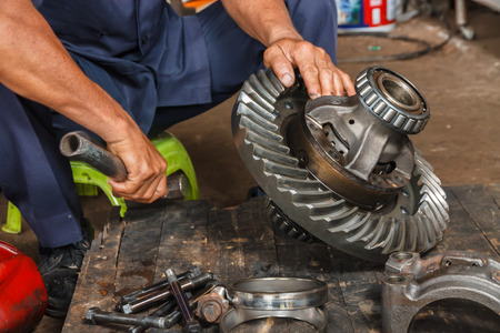 Professional car mechanic working in auto repair service. Stock Photo