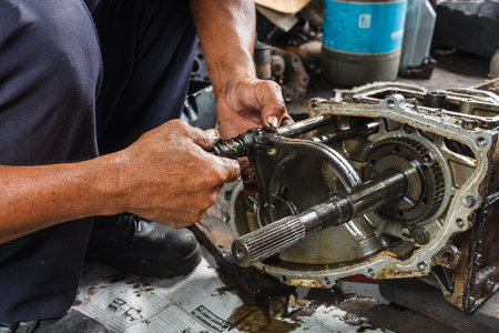 Professional car mechanic working in auto repair service. Stockfoto