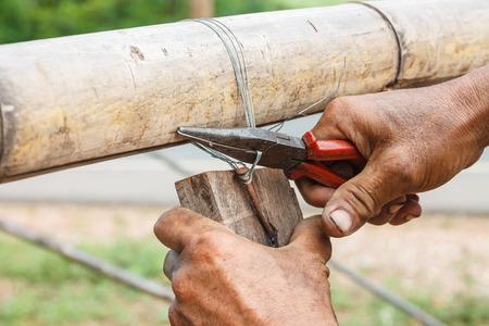 wire cutters: Using wire cutters, carpenters