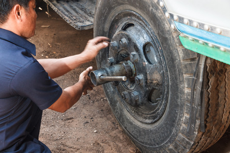 hand truck: Professional car mechanic working in auto repair service. Stock Photo
