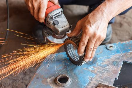 Repairing a car gear grinder.