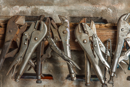 pliers hanging on a nail on the wall, engine repair. Reklamní fotografie