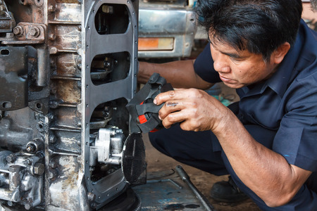 car mechanic working in auto repair service. photo