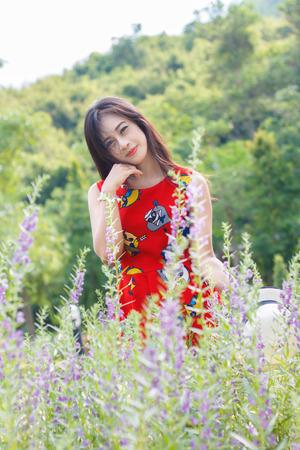 beautiful young woman in a flower field Reklamní fotografie
