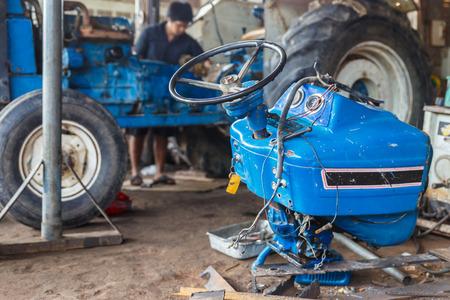 Repairing tractors, automotive mechanic. Reklamní fotografie