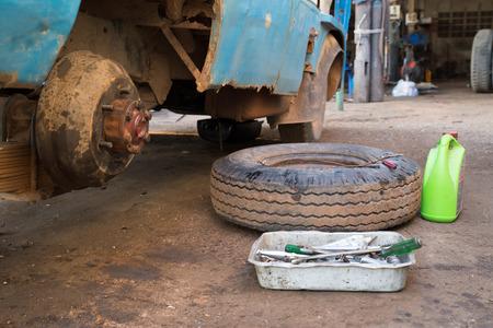 garage: The wheels were removed, truck repair garage.