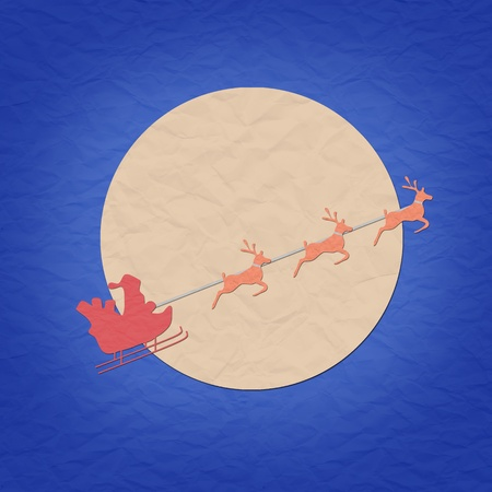 Santa on sledge with raindeer and moon paper craft  photo