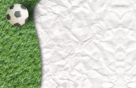 Plasticine Football on grass and  paper background photo