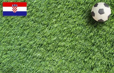 Plasticine Football on grass background  photo