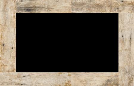 marco madera: Marco de madera sobre un fondo negro, el espacio para el texto Foto de archivo