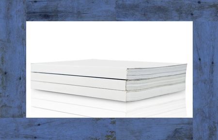 Blank book on blue wood frame photo