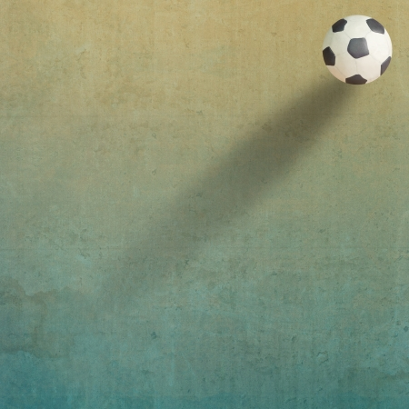 Plasticine Football on old paper background photo