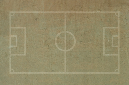 Soccer football field on grunge paper background photo