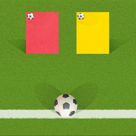 Plasticine football with referee cards on grass background  photo