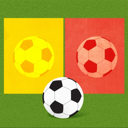 Football soccer with referee cards on grass background  photo