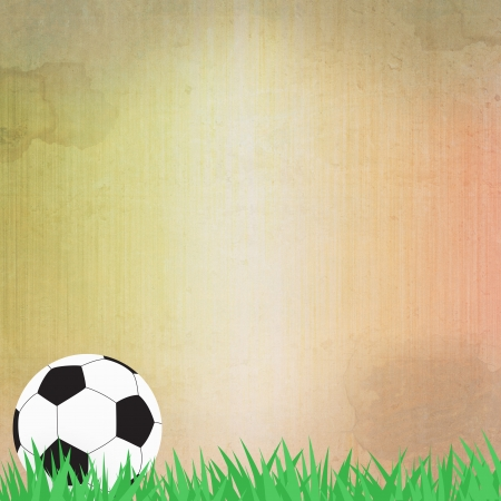 Football soccer on grass and paper background  photo