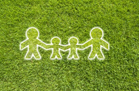 Icon family on green grass,  texture background