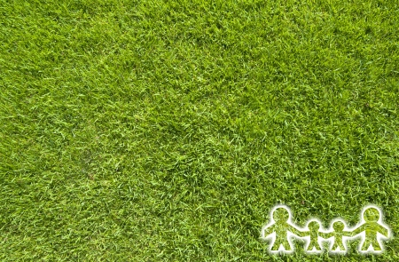 Icon family on green grass,  texture background photo