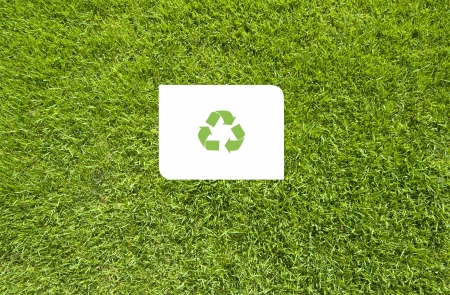 Recycle on Green grass,  texture background photo