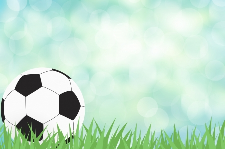 Football with green grass on color abstract  background photo