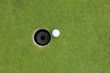 Golf Ball on Edge of Hole  写真素材