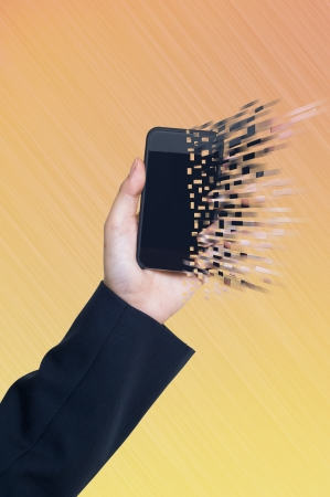 Smartphone with hand on abstract background photo