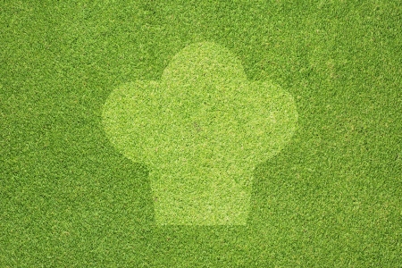 Chef icon on green grass texture and  background Stock Photo - 14427953