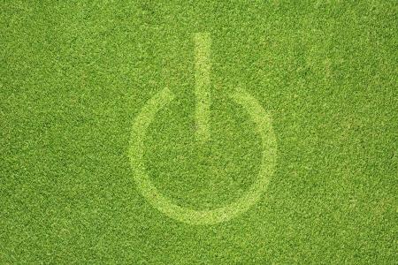 shutdown: Shutdown icon on green grass background Stock Photo